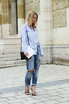 Refined and casual. Blue oxford shirt, ripped boyfriend jeans, and strappy black heels.
