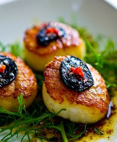 black garlic with scallops recipe Even if you don't have black garlic, this is a simple recipe for scallops. Just substitute the black garlic with regular garlic. Just don't expect any nooky tonight, unless you're both having the dish!3 tablespoons butter, divided