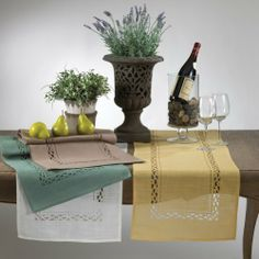 """Kips Bay Cutwork Table Runner. 16""""X67"""" Rectangular. One Piece. (Butter Yellow Color) by Kips Bay. $23.99. Hand wash. 100% polyester. 4 designer colors available. beautiful cutwork design. measures 16 inches by 67 inches. This cutwork table runner in modern style will add a luxurious touch to your table."""