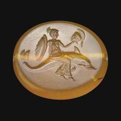 A GREEK BROWN CHALCEDONY SCARABOID CLASSICAL PERIOD, CIRCA LATE 5TH-EARLY 4TH CENTURY B.C.