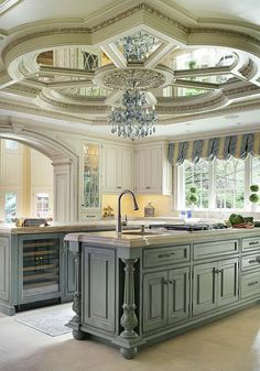 """Peter Salerno, Inc. Portfolio A Touch of Elegance 2nd Place Winner - Large Kitchen by the NKBA 2015 A traditional kitchen with some """"glitz & glam"""" featuring one of our custom reclaimed tin hoods, refrigerator panels, antiqued mirror ceiling, a La Cornue CornuFe 110, and a TopBrewer. Fun Fact: This was the first kitchen in the US to feature a TopBrewer! Amazing Ceiling as well!!"""