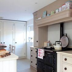 Above the Aga kitchen storage Kitchen Interior, Kitchen Design, Kitchen Decor, Kitchen Ideas, Kitchen Countertop Materials, Kitchen Countertops, Aga Kitchen, 25 Beautiful Homes, Aga Cooker