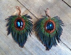 Items similar to Peacock feather embroidered beaded necklace with Swarovski crystal on Etsy Peacock Earrings, Beaded Tassel Earrings, Seed Bead Earrings, Fringe Earrings, Feather Earrings, Beaded Earrings, White Earrings, Seed Beads, Feather Jewelry
