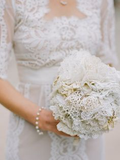 The bride crafted her bouquet using antique brooches and lace doilies that belonged to her grandmother.