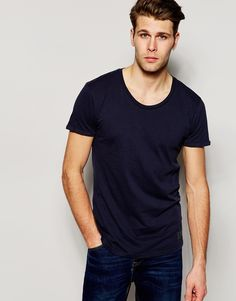 """T-shirt by Minimum Clothing Soft-touch, cotton jersey Scoop neck Regular fit - true to size Machine wash 100% Cotton Our model wears a size Medium and is 183cm/6'0"""" tall"""