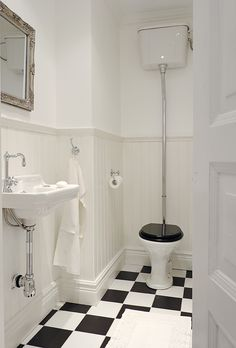 I absolutely love black and white tiles, especially in a vintage bathroom.