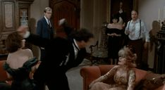 The Oscar-nominated character actress, who passed away Sunday at 80 from bladder cancer, had a long and varied career in classics like The Sting, The Last Picture Show, and Private Benjamin. But for many, she will be best remembered as the daffy and delightful Mrs. Peacock in 1985's Clue — here are her best moments.