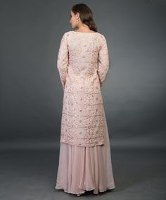 From our Wedding Festive Collection, this is a nude pink pure georgette sharara suit with intricate exquisite rose gold gota patti hand embroidery. The shirt has rose gold gota patti hand embroidery all over in lattice pattern. The pure georgette Pakistani Wedding Outfits, Pakistani Dresses, Indian Dresses, Indian Outfits, Indian Bridal Wear, Indian Wear, Brocade Blouse Designs, Gota Patti Suits, Pure Georgette Sarees