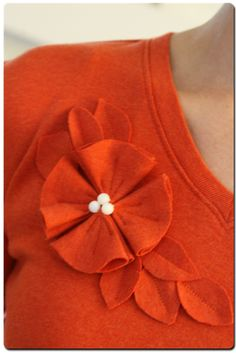 Long-sleeved shirt to flowered short-sleeve shirt.  This add-on flower & leaves design would look cute on a hat.  Just sayin'.