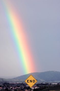 I can see a Rainbow behind the Black sky.
