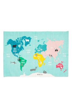 Rectangular cotton rug with a world map print on the top and anti-slip protectors on the bottom.