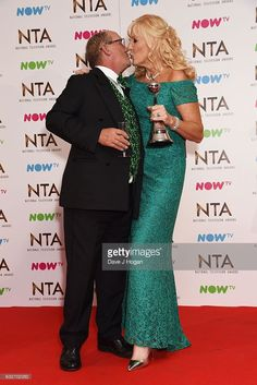 Brendan O'Carroll and Jennifer O'Carroll pose in the winners room at the National Television Awards at The Arena on January 2017 in London, England. Stock Pictures, Stock Photos, Award Winner, London England, Royalty Free Photos, Peplum Dress, Awards, January