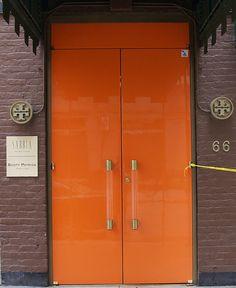 Paint closet doors orange| use lucite handles already own