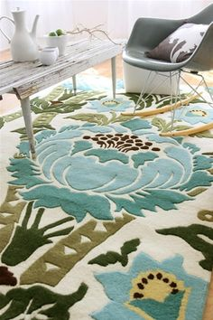 I love this Amy Butler rug, would so fit my new living room:)     House of Turquoise: Amy Butler Hand Tufted Wool Rug Coventry