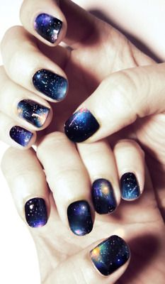 easy DIY galaxy claws! rich navy base with royal blue, seafoam green, & warm magenta glitter colours stipled around with a makeup sponge. I dabbed Obsessive Compulsive Cosmetics' silver glitter polish [vegan & cruelty free!] on afterwards to amp up the starriness & voila. we are galactic. - Debby Ryan tip on Galaxy nails!  LOVE!