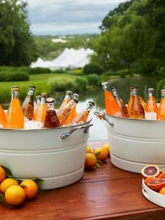 citrus orange soda drinks in white enamel buckets | matthew robbins design