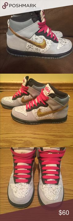 Nike Dunk 6.0 High Top Sneakers  These are lightly used Nike Dunk high 6.0 sneakers are in excellent condition. They are gray and white, with a gold Nike Check. These sneakers are a women's size 6 and are made of suede and leather, with material on the sides that have a spotty pattern. Hot pink shoe laces give these sporty shoes such a feminine touch!! These sneakers look adorable with skinny jeans and leggings!! All reasonable offers will be considered!!  Nike Shoes Sneakers