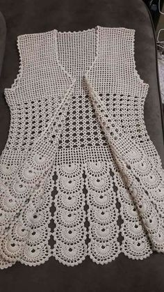 Lace Vest Crochet Pattern - This is a great summer time top that can be worn both ways - a 2 way top crochet pattern. It is a lace cardigan crochet pattern and a lace vest crochet pattern! This Pin was discovered by Hay Benzer Çalışmalar No related pos Débardeurs Au Crochet, Gilet Crochet, Crochet Cardigan Pattern, Crochet Jacket, Crochet Woman, Crochet Blouse, Lace Cardigan, Crochet Flower, Baby Knitting Patterns