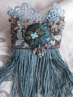 Mist over the water textile cuff. $50.00, via Etsy.