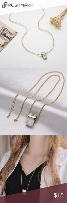 """Square Marble Gold Bar Drop Necklace ? New trendy howlite marble jewelry ? Howlite square marble necklace with a gold plated bar wrapped around the top. Size: .5"""" across 1"""" long Chain: 14.25"""" from neck down 28.5"""" around plus 2"""" extra of adjustable chain. Jewelry Necklaces"""