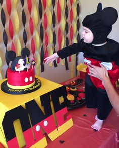 Mickey mouse birthday theme First birthday party Mickey mouse cake Mickey mouse birthday party Boy first birthday party
