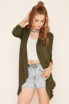 A lightweight heathered knit cardigan featuring a draped open-front and long sleeves.