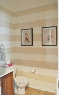 Neutral painted stripes/powder room  Emily Ann Interiors