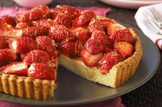 This toffee-laced strawberry and cardamom tart is a real showstopper.