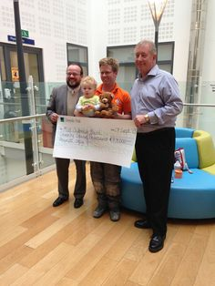 Rockinghorse and Hilton in the Community Foundation cheque presentation at the Royal Alexandra Hospital