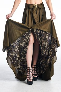 "Oh my goodness we love this skirt! Olive green with camo lining in our favorite fabric...cotton! The pockets are large, and have faux leather flowers and snap closure. Snap closure up the front of the skirt and wide belt. A 3"" elastic piece at the back waist gives this a little room for give. Waist measurements lying flat (double) Small 13"" , Medium 13.5"", Large 14"", XL 15"". Small is 45"" long.   Olive Maxi Skirt by MHGS. Clothing - Skirts - Statement Clothing - Skirts - Maxi Tampa, Florida"