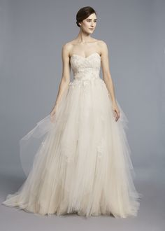BOUVIER - Anne Barge, Spring 2018   Wedding gown with sweetheart bodice of Alencon lace with hand painted beaded appliques and a textured tulle skirt.