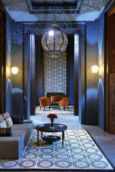 Royal blue @ The Royal Palm, located within a Common Area in the Royal Palm Morocco.  Mosaics, earthy colors, Moroccan lanter chandelier and deep blue hues make this space cravable.