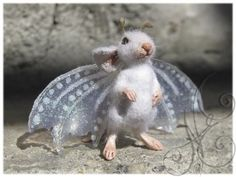 I hate the whole angel everything fad... so I am going for the offspring of an albino bat & country mouse secret love affair. (too cute not to pin)