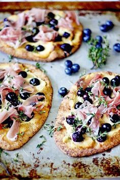 """Blueberry Pizza with Honeyed Goat Cheese and Prosciutto -- Naan bread and Trader Joe's Honey Goat Cheese logs make these """"mini pizzas"""" super easy to prepare. Love when sweet and savory come together in an unusual, gourmet way! I Love Food, Good Food, Yummy Food, Yummy Recipes, Prosciutto Pizza, Do It Yourself Food, Blueberry Recipes, Calzone, Stromboli"""