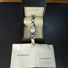 Nova Check Strap Burberry Watch Authentic Burberry Nova Check Strap fabric watch. It is 50M/165 feet. The strap and back of watch are in great condition. The crystal glass has scratches all around, but can easily be replaced. The battery works great, but can also be replaced in the future. It comes in the original box and has the card/booklet of authenticity. Burberry Accessories Watches