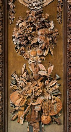 Intricate wooden carving by the master, Grinling Gibbons in Petworth House, England