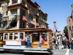 A cable car passes through Chinatown, one of the distinct neighborhoods that characterize San Francisco. [Photo by Susan Seubert, National Geographic]