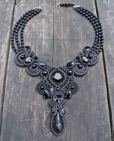 Stylish expressive black necklace in soutache technique with lots of Swarovski crystals and designers cabochon. Necklace is based on 3 rows of black Swarovski pearls. Gothic Jewelry, Boho Jewelry, Jewelry Crafts, Beaded Jewelry, Jewelery, Shibori, Handmade Necklaces, Handmade Jewelry, Soutache Necklace