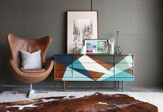 before-and-after furniture makeover - Further proof that peg legs can instantly transform any piece. Add a fresh layer of wood stain and a geometric paint pattern, and you've got a chic, mid-century modern accent piece worthy of your living space.