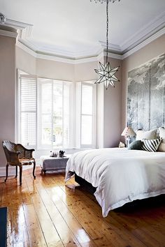 star pendant • moulding • artwork headboard • beautiful window
