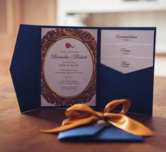 Beauty and the Beast themed wedding invitation. Luxury pocket wallet with midnight blue and old gold ribbon and pretty cameo charm... stunning!