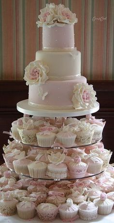 wedding cake w cupcakes. Here's an example of the decorated cupcakes. :) Like how the cupcakes have different decorations like butterflies. Pretty Cakes, Beautiful Cakes, Amazing Cakes, Wedding Cakes With Cupcakes, Cupcake Cakes, Cupcake Ideas, Pink Cupcakes, Cupcake Tier, Flavored Cupcakes