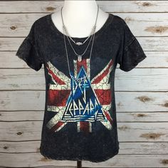 """[Boho Luxe] Def Leppard Graphic Tee Distressed Top Awesome rock n roll Def Leppard graphic tee. Acid wash finish with distressed looking artwork. Short sleeves with dropped shoulder. Slightly cropped length. Label is so faded it's hard to read, but fits like a Small.  Fabric: 100% Cotton  Bust: 18"""" Length: 21"""" Condition: EUC. No flaws. Distressed by design.  No Trades! Tops Tees - Short Sleeve"""