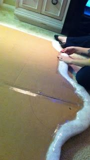 Cheapskate headboard using cardboard. Well why not, I say.