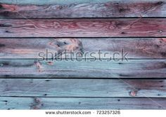 Close-up of the multicolor surface (wall, floor or overhead) made of wooden plank, panel or board in the turquoise, blue, red, claret, coral shades
