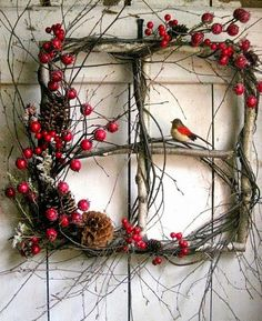Rustic Christmas window wreath with berries and bird. (old windows from rental house) Noel Christmas, Rustic Christmas, Christmas Projects, All Things Christmas, Winter Christmas, Holiday Crafts, Outdoor Christmas, Christmas Ornament, Natural Christmas Decorations