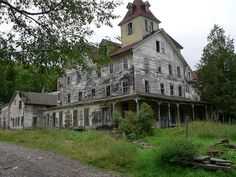 """Cold Spring House"" -- [An abandoned hotel located in *Tannersville, Greene County, New York, New York.* Opened c 1800's and closed sometime in the 1960's. It is situated in the heart of the Catskill Mountains at the foot of one of the highest peaks.]~[Photograph by Kurt Christensen - July 23 2006 - Tannersville, New York - US]'h4d-142.2013'"