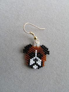 For those among us that prefer a smaller earring, these adorable little Boxer earrings fit the bill. They measure about 7/8 inch wide and 1 inch long, excluding the ear wires, and are made from approximately 296 tiny seed beads intricately woven, one at a time, with a needle and thread to create the finished earrings you see here. The pierced fish-hook ear wires are gold plate over surgical steel. If you prefer that your cute little dogs dangle from the post type or clip on type please...
