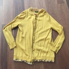 J crew ruffle cardigan sz XS J crew ruffle cardigan sz XS - size tag has been removed but it is an XS! Mustard yellow cardigan with ruffles! Adorable and soft! J. Crew Sweaters Cardigans