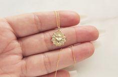 #jewelry #jewelrydesigner #jewelryphotography #14k #14kgold #weddingjewellery #gold #catholic #daintyjewelry Coin Necklace, Arrow Necklace, Jewelry Shop, Jewelry Design, Catholic Jewelry, Jewelry Photography, Sacred Heart, Dainty Jewelry, 14 Karat Gold
